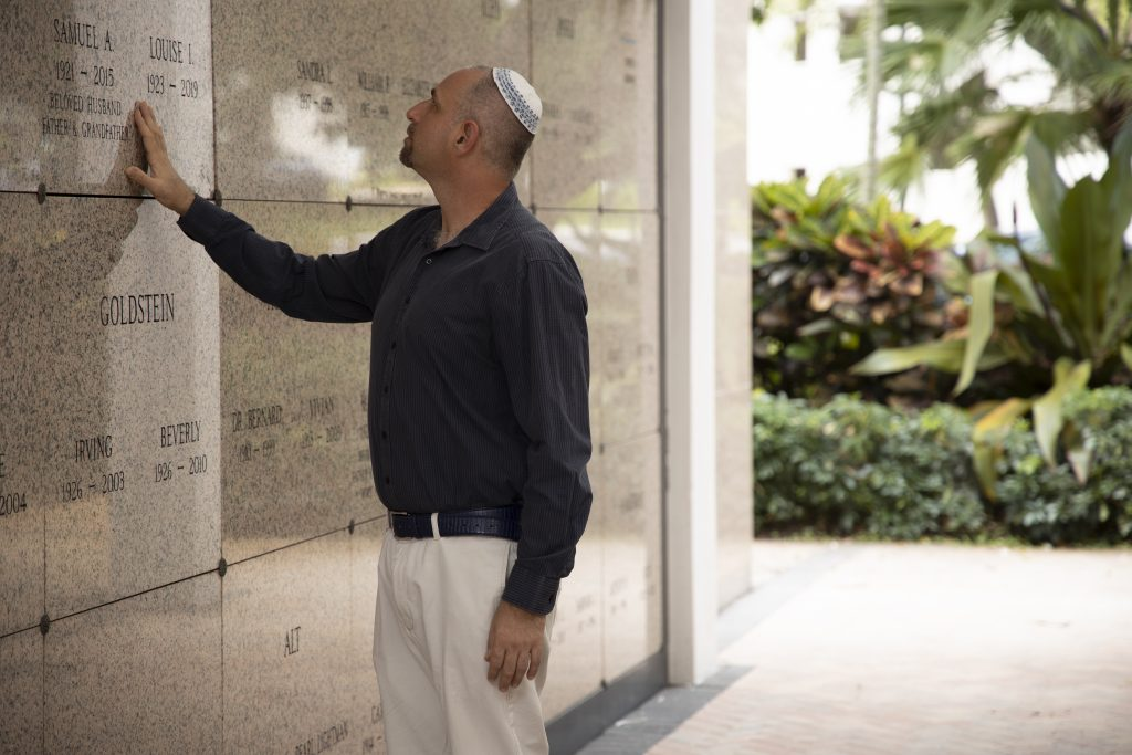 Man visiting a loved one at the Beth El Mausoleum