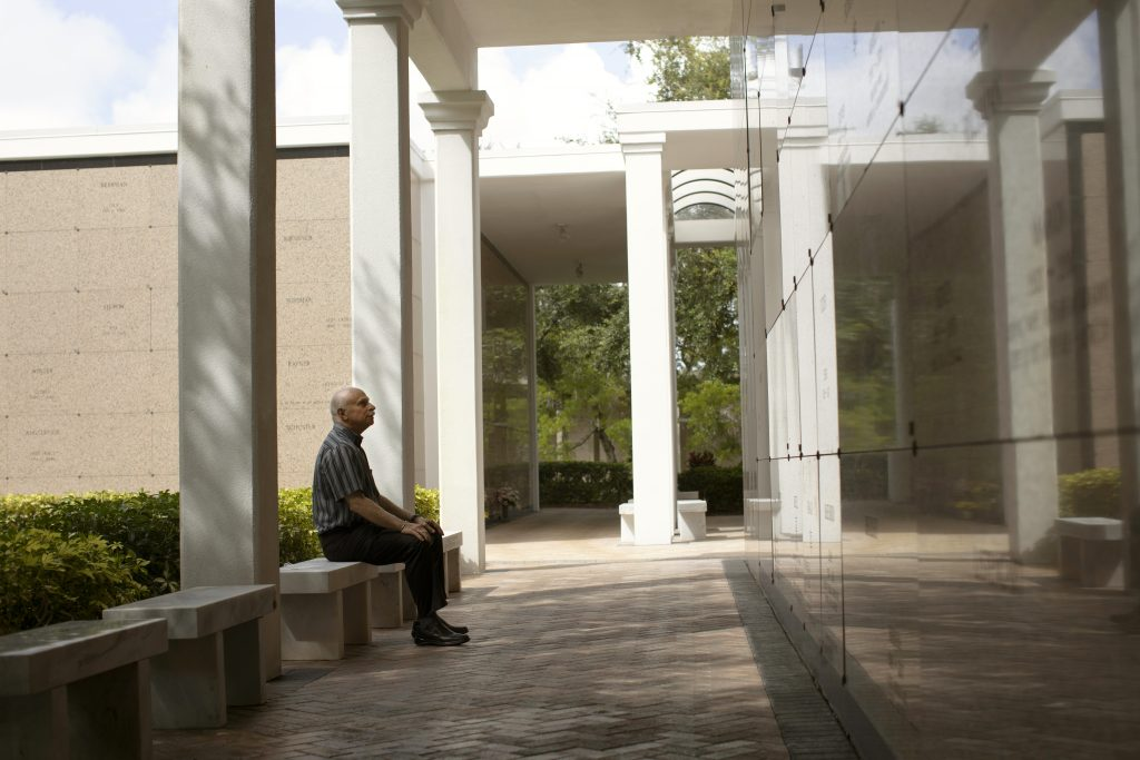 Man Sitting on a Bench in the Breezeways located at the Beth El Mausoleum, located on the Schaefer Family Campus of Temple Beth El in Boca Raton, FL